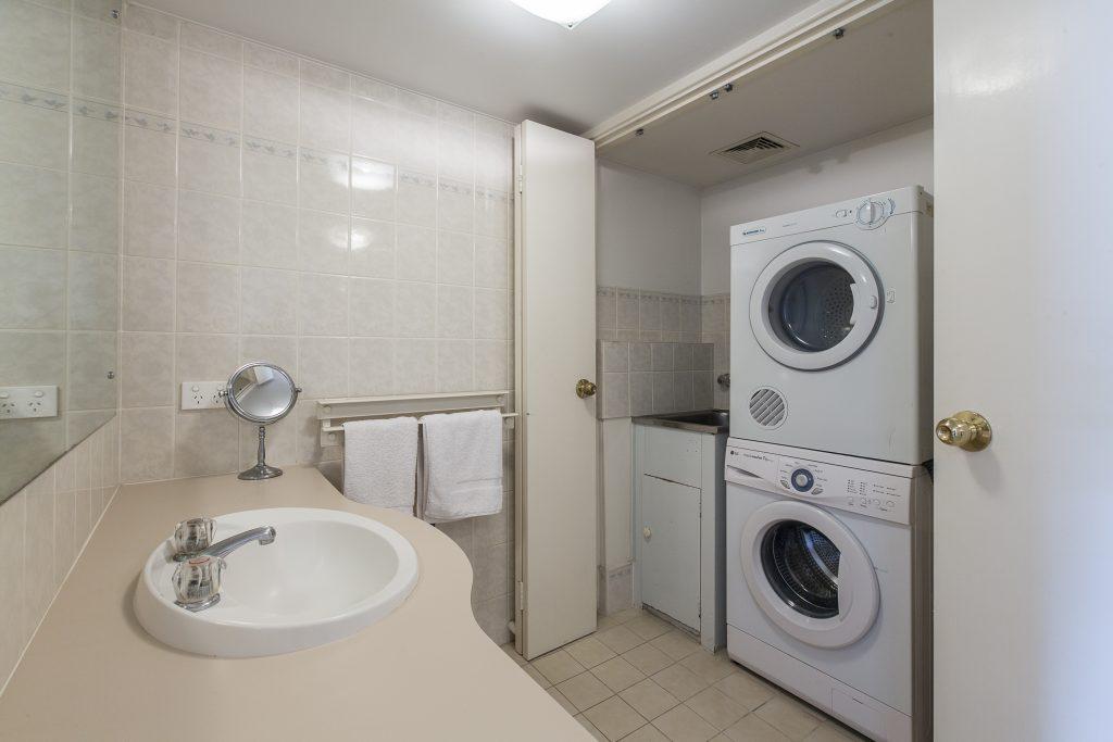 Cottesloe Cove Apartment laundry cupboard