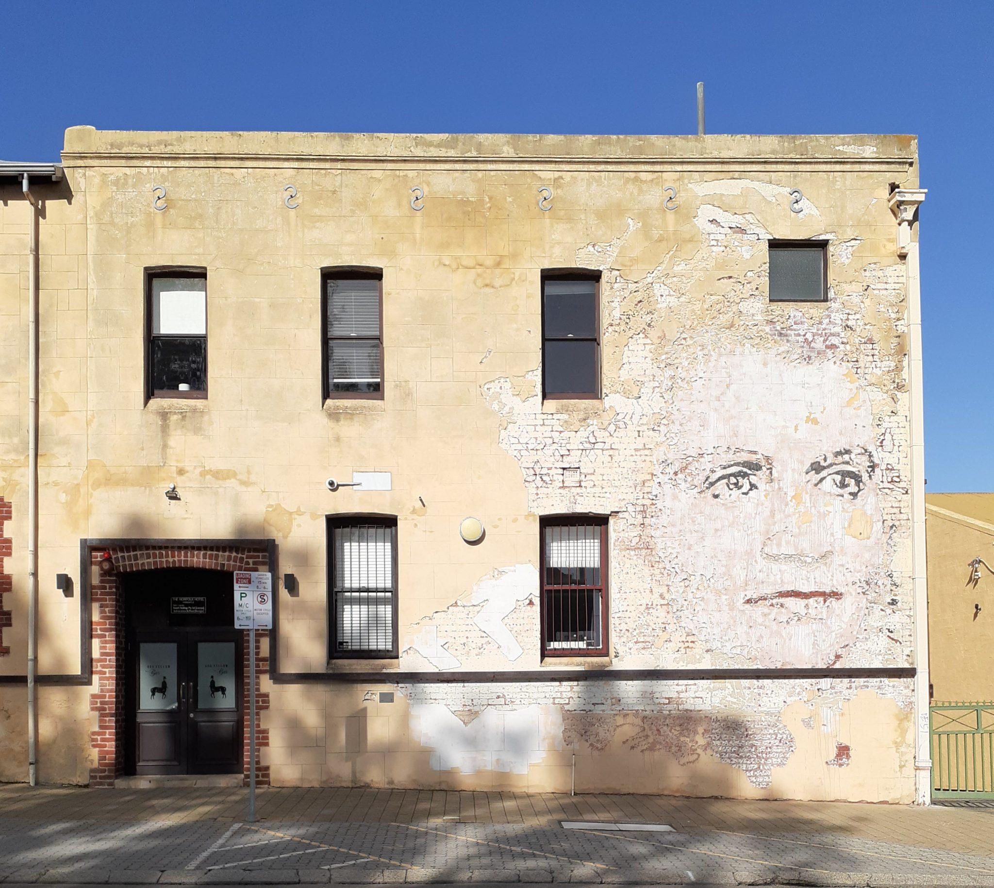 Faces in building facades on Norfolk street Fremantle